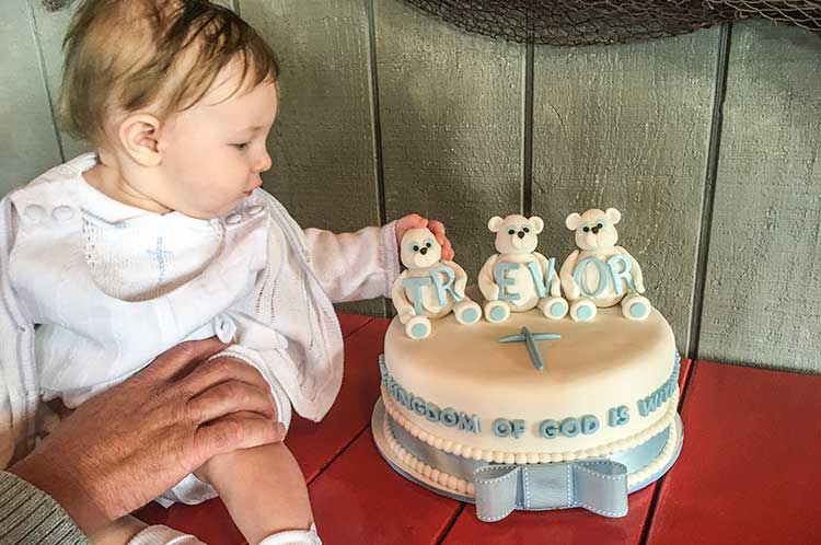baby-with-baptism-cake
