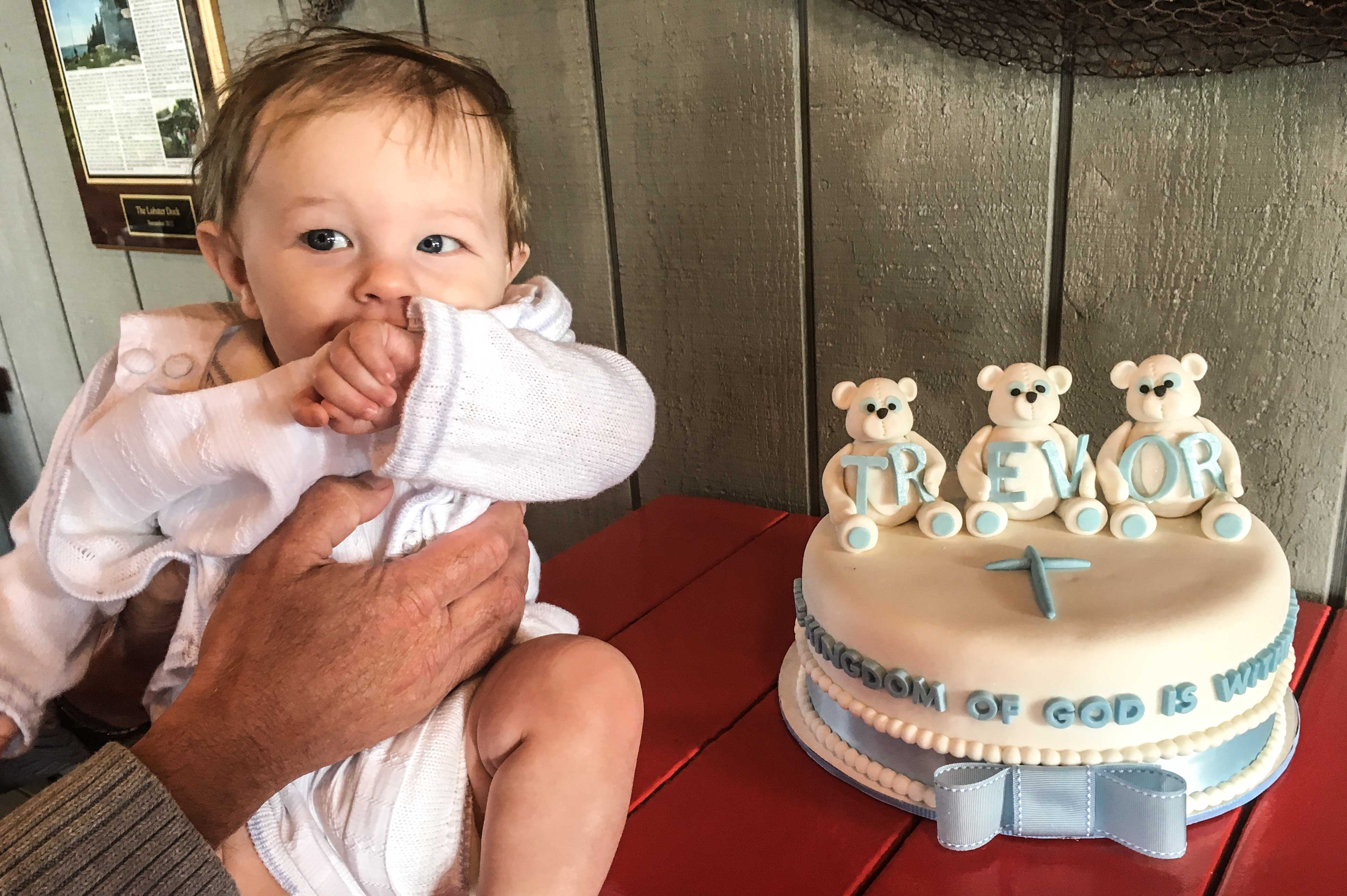 baby-with-his-baptism-cake